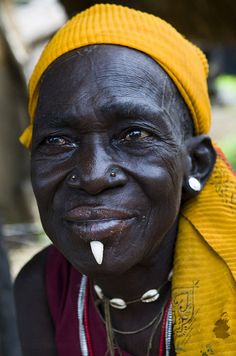 Portrait of an old Somba (Betammaribe ) woman taken in her village. Some of the older women can be seen with a tooth of a wild boar inserted in their chin. Photo taken in the Kara region in north eastern Togo, on the border of Benin. 2010