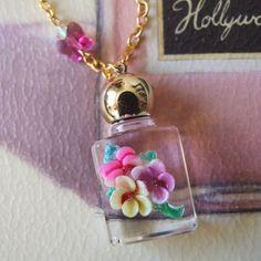 Gorgeous perfume bottle pendant ( So beautiful Thank you forever precious @Catarina Pereira <3 )