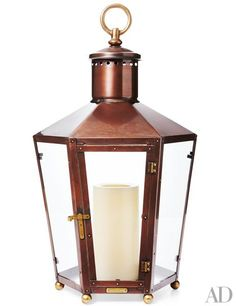 The portable Rault copper poolhouse lantern by Bevolo Gas and Electric Lights adds the warmth of candlelight to any space, indoors or out