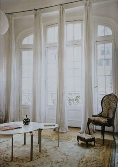 .curtains create a soft column in the room