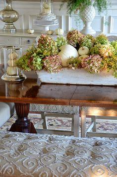 Autumn centerpiece with dried hydrangeas and white pumpkins...