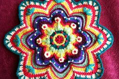 crocheted mandala...just love the burst of colors