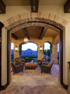 I could relax and read for hours on this Tuscan style veranda/porch...