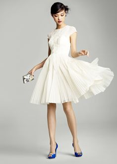 Love this textured LWD (little white dress!) with a swingy skirt.