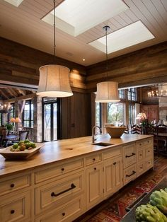 Large Rustic Kitchen in Warm Colors Ornate lighting over table and simple like this over work area