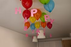 hanging HAPPY BIRTHDAY from ballons