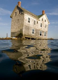 The last house on Holland Island, MD... collapsing in to the bay