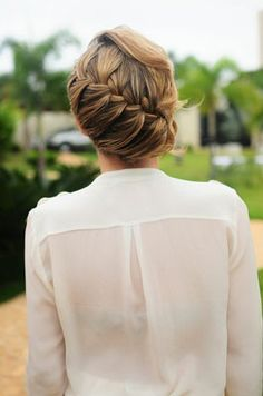 Like the loose side french braid, but would add low bun closer to the back.