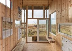 Timber cabin by TYIN Tegnestue overlooks wild Norwegian landscape.