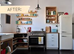Smeg refrigerator, open shelving, butcher block countertops, Ikea double Domsjo farmhouse sink