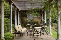 Love this comfortable patio setting, complete with flowers in a vase, candles and more. Decor by Parker James, via Roger's Gardens.