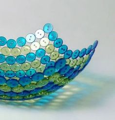 Create a unique and eye-catching bowl by carefully glueing plastic buttons together on a balloon and letting dry overnight. Then, let the air out of the balloon for a new kind of masterpiece!