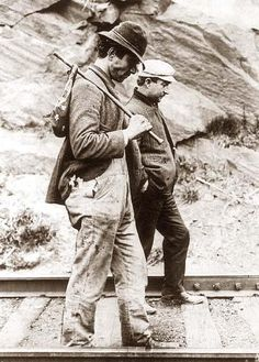 Two hobos walking along railroad tracks, after being put off a train during the Great Depression. The picture shows an iconic image of the Great Depression.