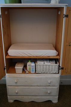 an old entertainment center with pull-out shelf as a hidden baby changing table - genius!