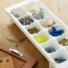 Organize Tool Supplies with Ice Cube Trays - 150 Dollar Store Organizing Ideas and Projects for the Entire Home