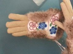 Beadwork at the Anchorage airport, best picture I could get with the glare of the glass. Still lovely gloves :)