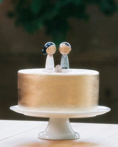 simple gold cake with cheeky toppers