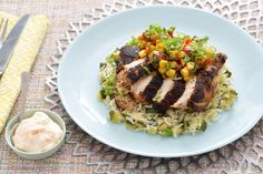Blackened Chile-Dusted Chicken with Zucchini Rice Pilaf & Corn-Tomato Salsa. Visit http://www.blueapron.com/ to receive the ingredients.