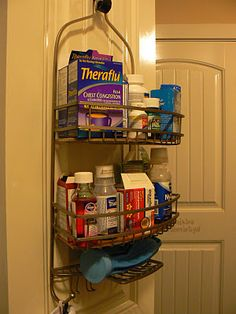 I hung a shower organizer on my linen closet door.  It holds plug-ins, jewelry cleaner, bottles of hand-soap and the like.  I KNEW I held on to that baby for something!
