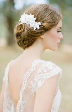 Lovely updo with a pearl bridal hair comb tucked in.