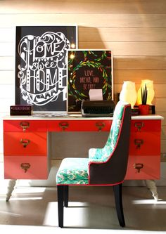 red desk, floral chair, and a modern desk