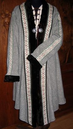 Caftan from the customer gallery at Die Wollhex, a German commercial site.  Note the strips of tablet-woven trim running down the outside of the arm--I know of no evidence for this in a Viking context.