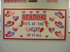 """Reading: It's at the heart of it all!"" is an nice idea for a Valentine's bulletin board display that has a reading theme."