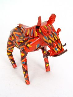 Small Tin Warthog  $24.00. You never knew warthogs could be so cute! Even cuter is the fact that ours are hand painted and made from recycled tin cans by artisans in Zimbabwe. Thats what we call eco-cute!