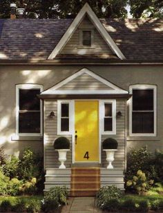 yellow front door and house number