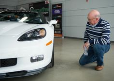 Jim DeGreve checking out his new 2013 60th Anniversary Corvette.