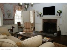 Currently used as a family room - originally the dining room.  Walls have hand painted murals from well known illustrator in 1910. Fireplace makes for cozy movie nights.  Find this home on Realtor.com