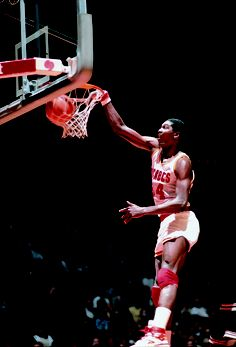 Hakeem dunking early in his career.    For the latest Rockets news & updates, visit www.rockets.com.