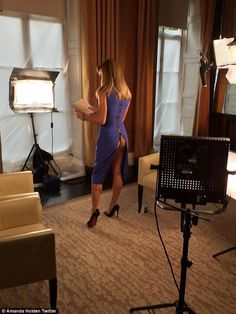 Amanda Holden purple sleeveless bodycon midi dress which zipped up at the back made sure the number was undone to just above her pert posterior and wore Louboutin heels rehearsing for This Morning