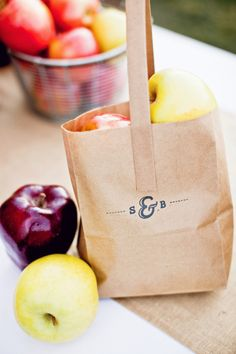 DIY stamped apple bags. Photography by jacquelynnbrynn.com, Floral Design by acebook.com/BloomersFlowersWenatchee, Read more - http://www.stylemepretty.com/2013/06/19/diy-backyard-wedding-from-jacquelynn-brynn-photography/