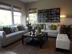 This Contemporary Living Room features one consistent accent color to liven up their neutral color scheme. Design by Studio Hill Design