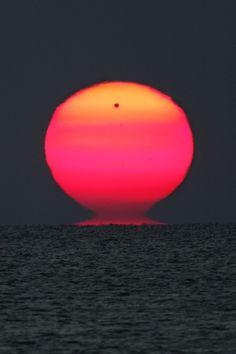 Venus rises with the sun at dawn across the Black Sea.