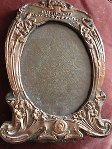 Art Nouveau Copper faced photo frame. Oak back, hinged stand