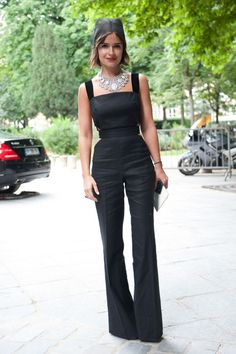 Miroslava Duma in a black jumpsuit and statement necklace