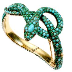 Elegant Victorian snake bangle bracelet with cabochon turquoise beads. Designed as a coiled snake with large cabochon turquoise crowning the head. Cabochon ruby eyes.   Marked with French hallmark of an owl.