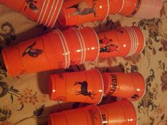Hunter orange solo cups I decorated with scrapbook stickers for a Duck Dynasty/ hunting theme birthday party.