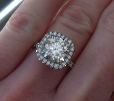 Round Diamond with a Cushion Halo. no words!