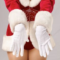 """The """"Rockettes Red Santa"""" is one of the most signature Rockette looks and was designed by Pete Menefee and was introduced by the Rockettes in 1982."""