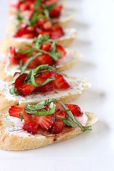 strawberry bruschetta .. YES PLEASE   * 1 cup strawberries, hulled and diced  * 1 tbsp. sugar  * 1 French baguette, sliced on a bias  * 4 oz. goat cheese  * 1 tbsp. olive oil  * 2 tsp. balsamic vinegar  * ¼ cup minced basil leaves  * Freshly ground black pepper    Directions    1. Combine the strawberries and sugar in a small bowl; toss to combine.   2. Let the berries macerate for about 30 minutes so that they begin to release their juices.   3. Spread a thin layer of goat cheese on top of e...