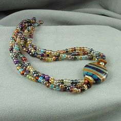 Lampwork Necklace Multi Stand Beaded by ArtfulHandJewelry on Etsy, $54.00