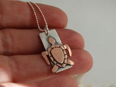 Sweet little turtle necklace - hand drawn, hand cut turtle in copper layered on sterling silver, mixed metal, metalsmith jewelry by JoDeneMoneuseJewelry on Etsy, $45.00