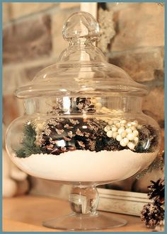 Apothecary jars with epsom salts & pinecones. *grins* My kind of pretty all-winter decorating!