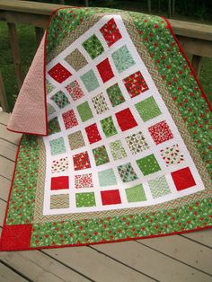 Christmas Quilt--love how the white shows off the patterns of the fabric.