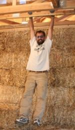 Design 7. Designing the Straw Bale Toe Up  By Chris Keefe  In designing or building a straw bale wall, one of the most important issues is keeping water away from the bales. Large overhangs above the walls help to keep the water from reaching the bales from above. From below we utilize toe-ups. toe-up serves to elevate the bale wall above the floor where water can reach the bales and wick up into the straw from below.