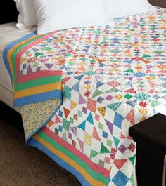 Pieced from as many reproduction prints she could gather at a fabric exchange, Liz Porter's quilt, Emily's Wedding, features a masterful combination of the 54-40 or Fight quilt block and the Shoo Fly quilt block.