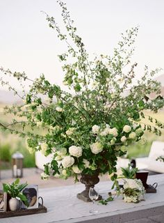 Floral centerpieces with lots of greenery.
